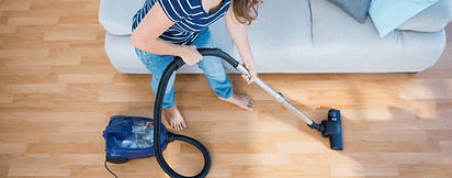 Woman Vacuuming Wood Floor